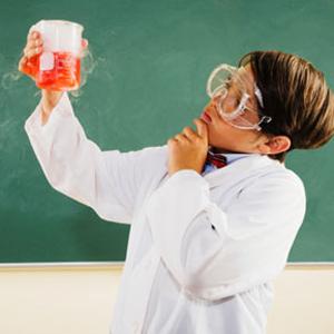 Hispanic boy dressed as scientist