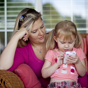 Renee Giroux-Nix's daughter, Bella, 3, plays games and uses educational apps on her mother's iPhone, in Cedar Park, Texas.