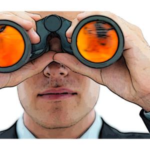 Young business man looking through binocular