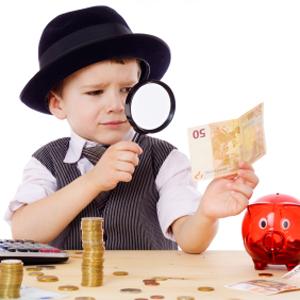 Little businessman checks the money