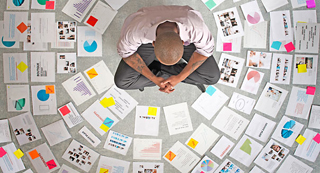 Businessman surrounded by papers