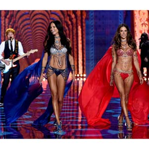 Ed Sheeran performs as Adriana Lima and Alessandra Ambrosio walk the runway. (Dimitrios Kambouris/Getty Images for Victoria's Secret)