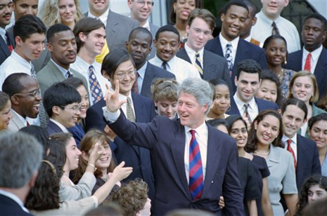President Bill Clinton signs ?I love you? to White House interns as he leaves the White House in Washington Monday, June 27, 1994 for New York. The president was to attend the Democratic National Committee?s Gala Reception. (AP Photo/Wilfredo Lee)