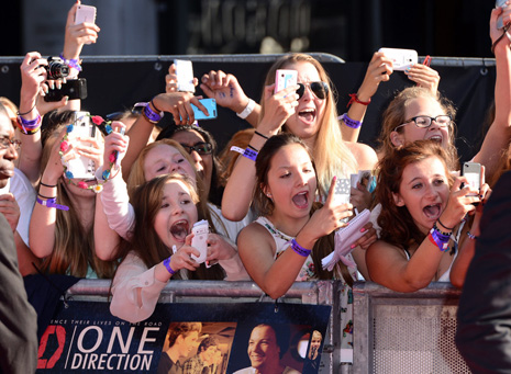 LONDON, ENGLAND - AUGUST 20: Fans at the World Premiere of 'One Direction: This Is Us' at Empire Leicester Square on August 20, 2013 in London, England. (Photo by Karwai Tang/WireImage)