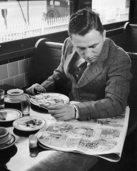 1959, A young man reads a comic book over breakfast in a diner. (Photo by FPG/Getty Images)