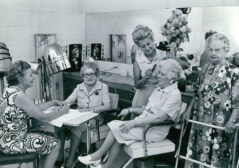 AUG 25 1971, AUG 31 1971, SEP 5 1971 Mrs. John Streltzer, left, manicures the nails of Mrs. Sadie Thaler, and Mrs. Ben Pitler combs Mrs. Mary Goldman's hair while Mrs. Ida Fink awaits her turn. The free services are available to residents of Beth Israel. Credit: Denver Post, Inc.