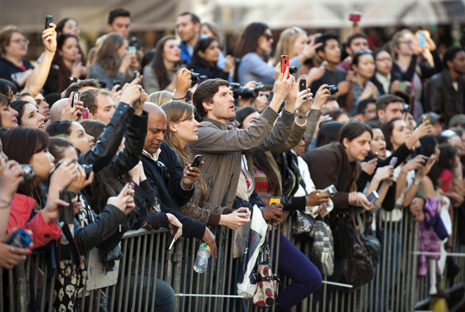 Fans stretch for a look at the stars as they arrive at the World Premier of The Great Gatsby May 1, 2013 at Avery Fisher Hall at Lincoln Center New York. Leonardo DiCaprio stars in the title role. AFP PHOTO/Don Emmert        (Photo credit should read DON EMMERT/AFP/Getty Images)