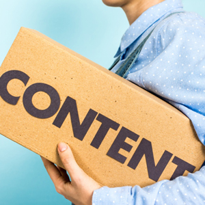 Content marketing distribution concept. Woman carrying a box wit