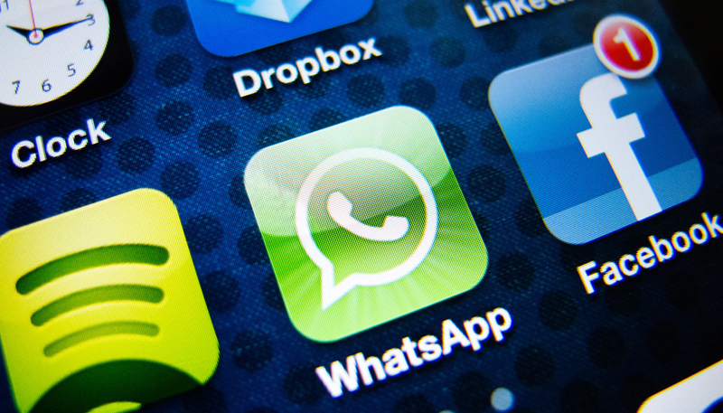 detail of iPhone 4G screen showing Whatsapp instant messaging app icon