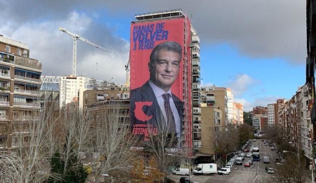 Laporta cubre un edificio próximo al Bernabéu con una enorme lona en la que aparece su rostro